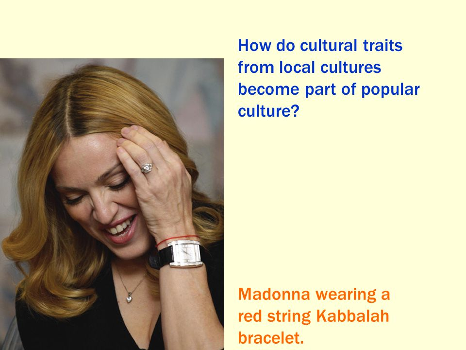 How do cultural traits from local cultures become part of popular culture