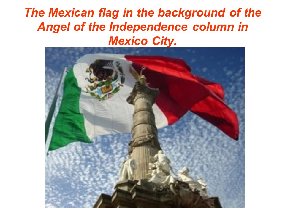 The Mexican flag in the background of the Angel of the Independence column in Mexico City.