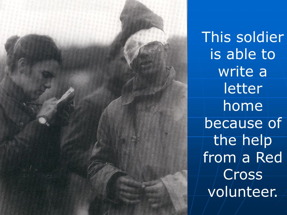 This soldier is able to write a letter home because of the help from a Red Cross volunteer.