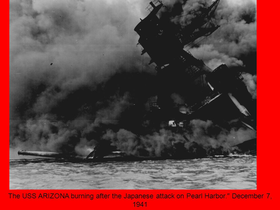 The USS ARIZONA burning after the Japanese attack on Pearl Harbor