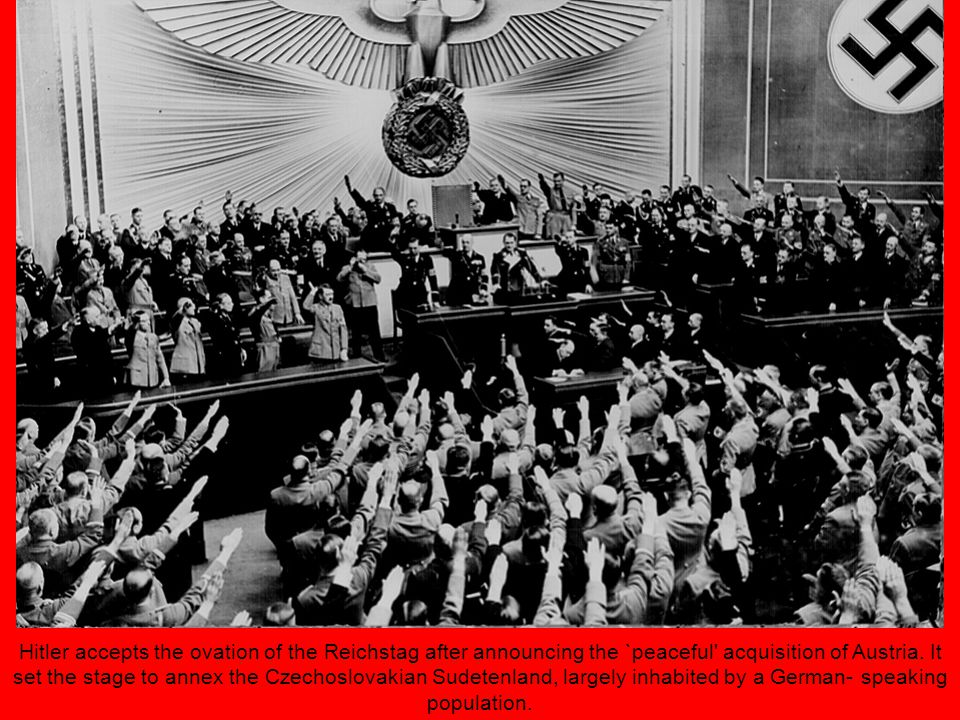 Hitler accepts the ovation of the Reichstag after announcing the `peaceful acquisition of Austria.