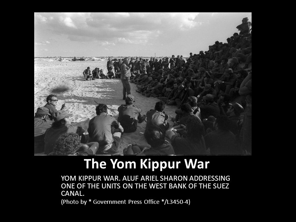 The Yom Kippur War YOM KIPPUR WAR. ALUF ARIEL SHARON ADDRESSING ONE OF THE UNITS ON THE WEST BANK OF THE SUEZ CANAL.