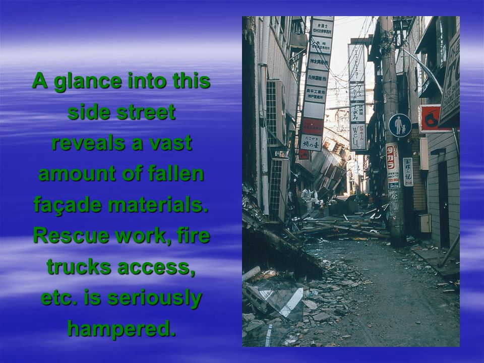 A glance into this side street reveals a vast amount of fallen façade materials.