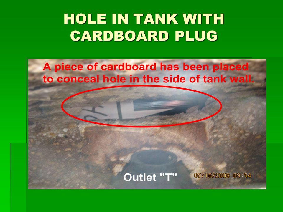 HOLE IN TANK WITH CARDBOARD PLUG