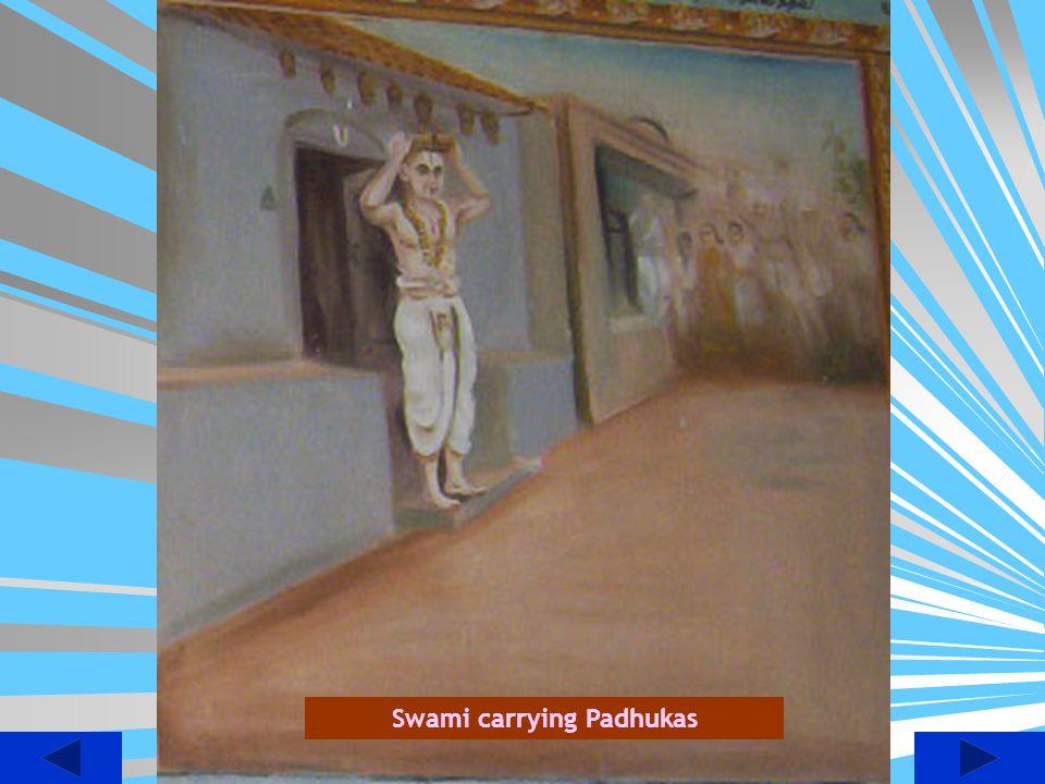 Swami carrying Padhukas