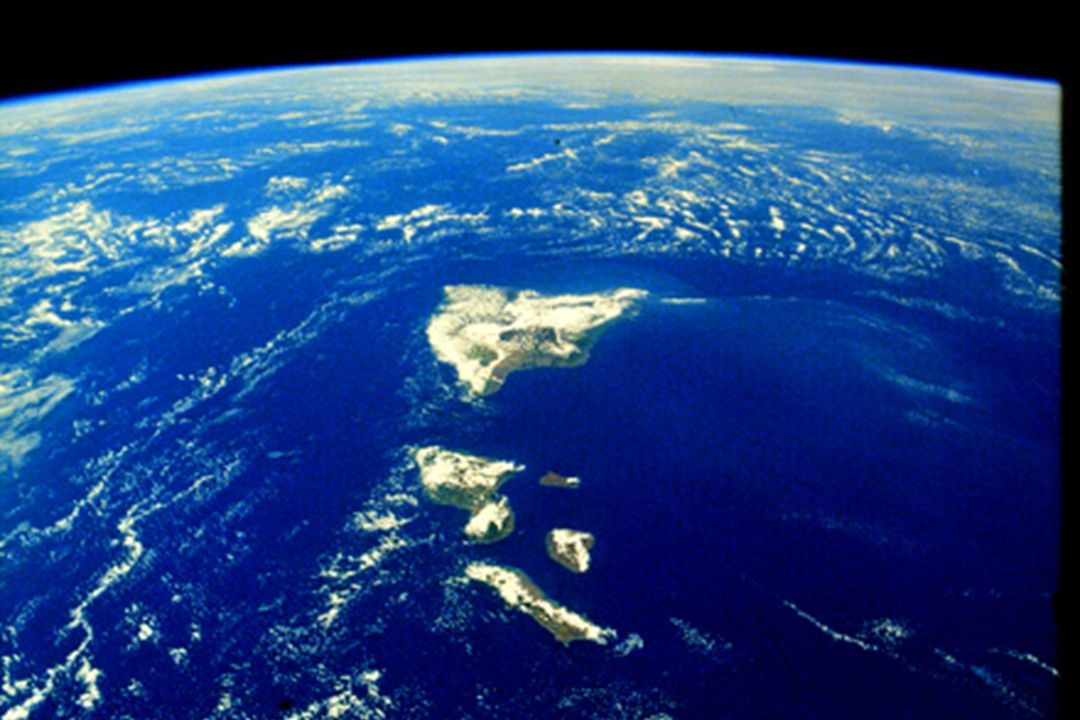 The Earth as seen from Space Shuttle Columbia on SLS-1 (STS-40) Oahu is the the foreground followed by Molokai, Lanai, Maui and Hawaii.