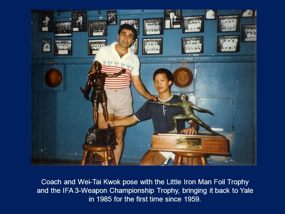 Coach and Wei-Tai Kwok pose with the Little Iron Man Foil Trophy and the IFA 3-Weapon Championship Trophy, bringing it back to Yale in 1985 for the first time since 1959.