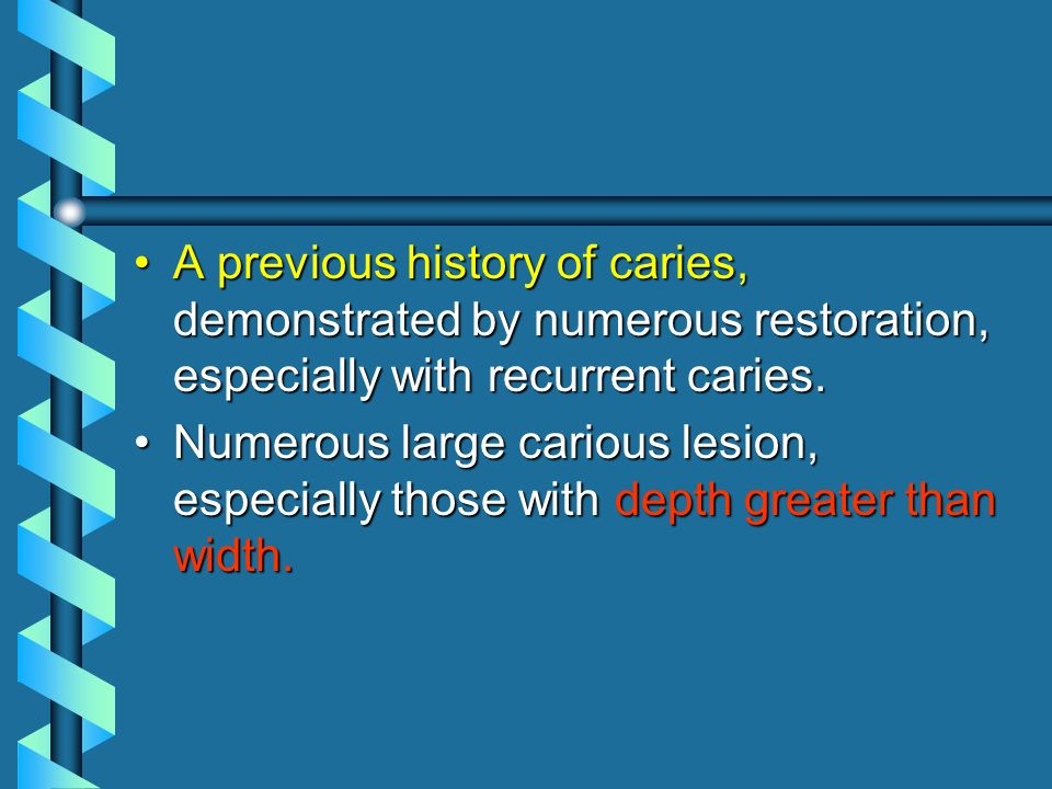 A previous history of caries, demonstrated by numerous restoration, especially with recurrent caries.