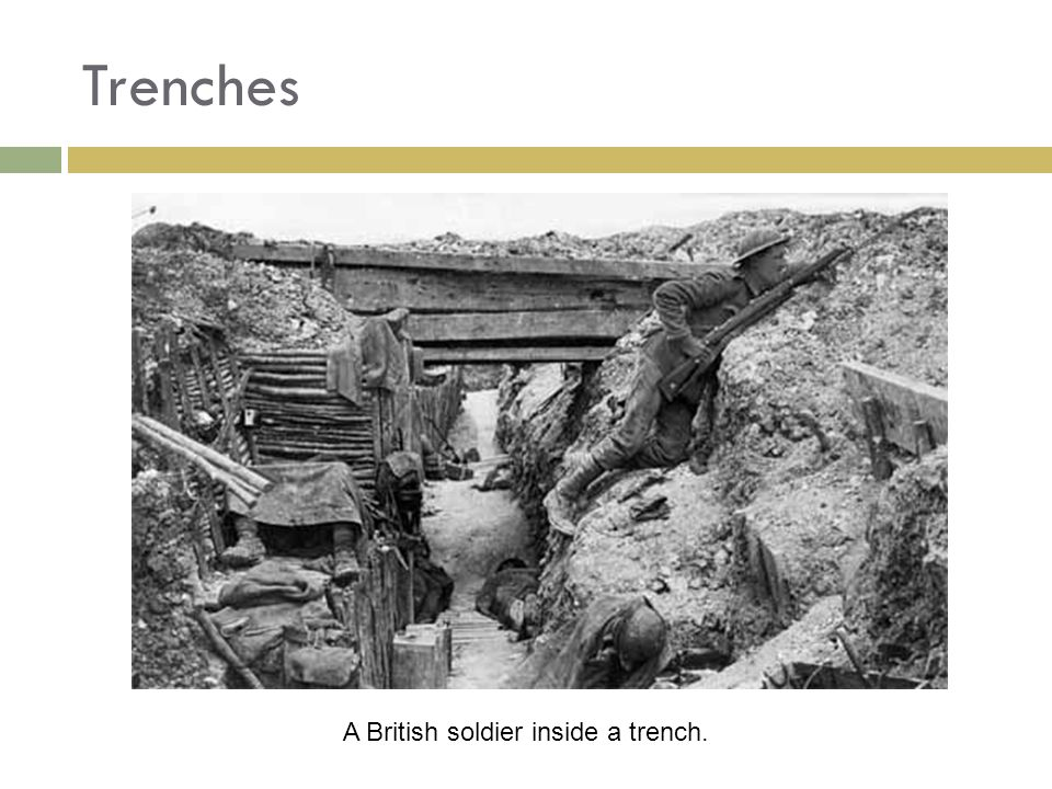 A British soldier inside a trench.