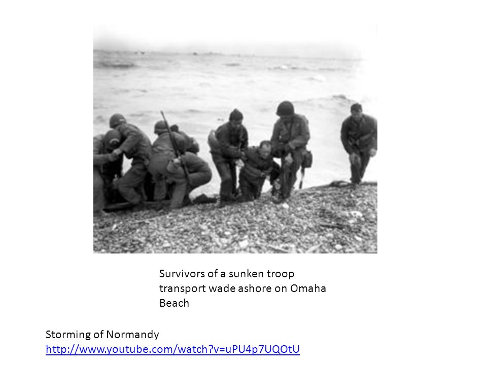 Survivors of a sunken troop transport wade ashore on Omaha Beach
