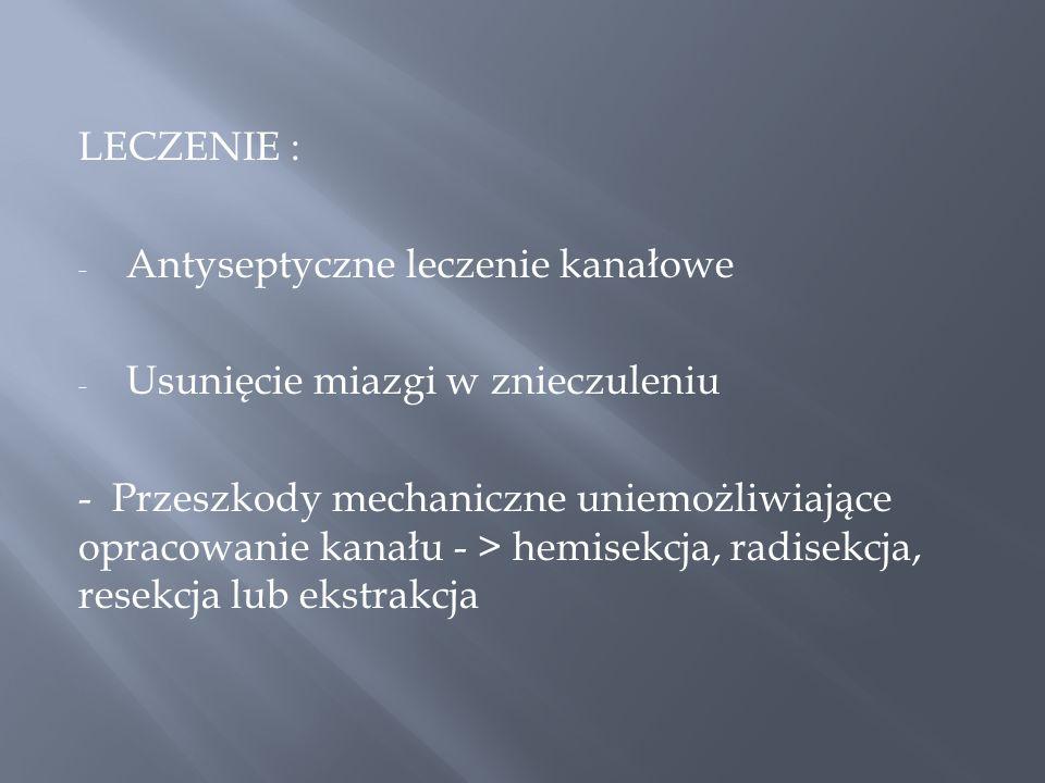 LECZENIE : Antyseptyczne leczenie kanałowe. Usunięcie miazgi w znieczuleniu.