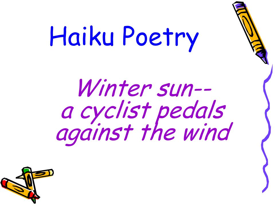 Winter sun-- a cyclist pedals against the wind