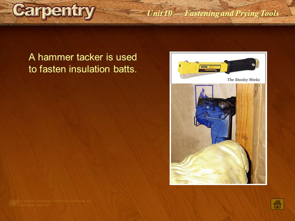 A hammer tacker is used to fasten insulation batts.
