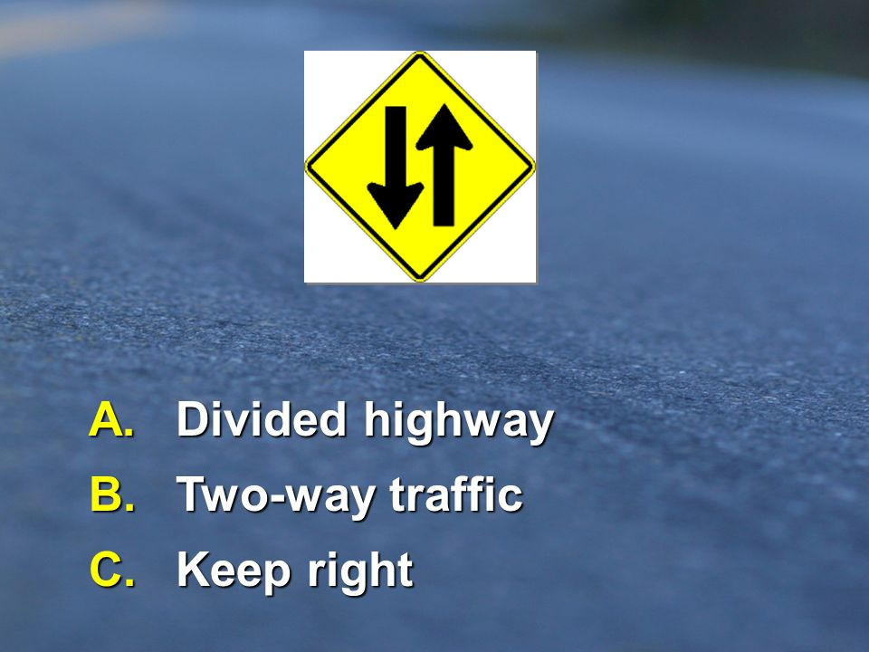 A. Divided highway B. Two-way traffic C. Keep right