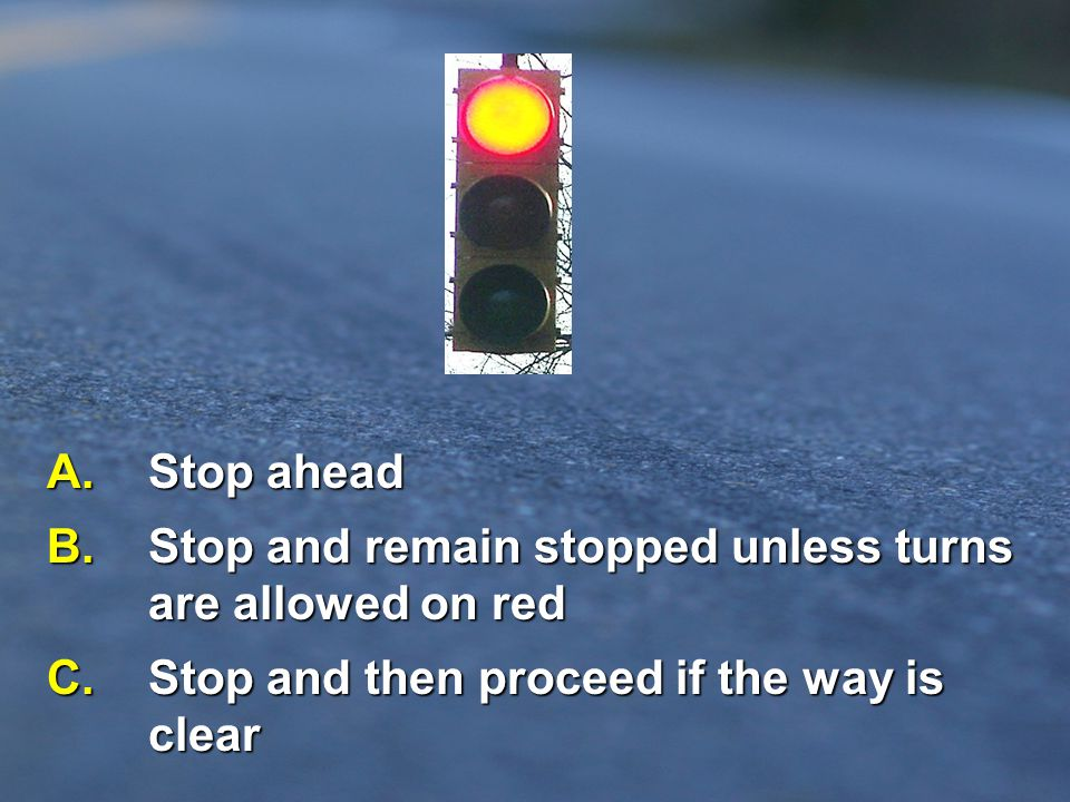 B. Stop and remain stopped unless turns are allowed on red