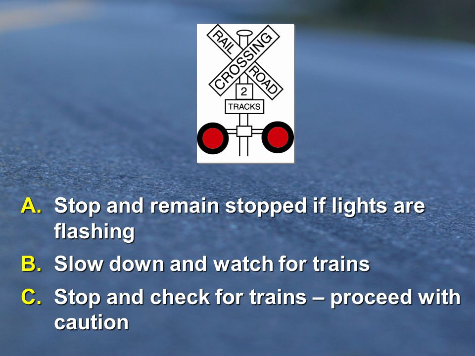 A. Stop and remain stopped if lights are flashing
