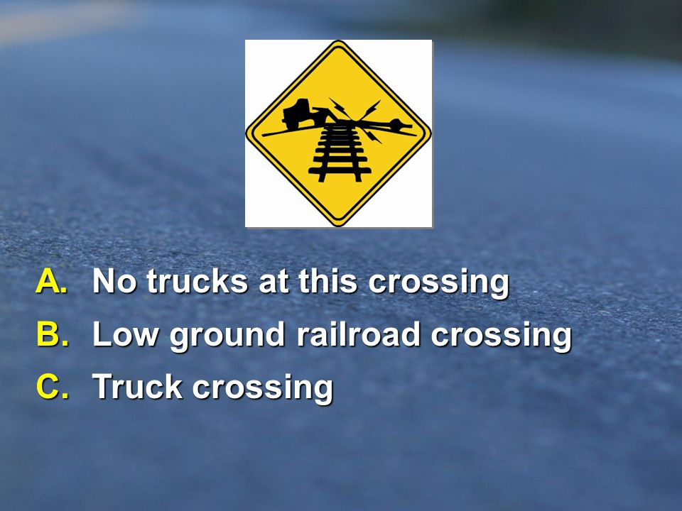 A. No trucks at this crossing B. Low ground railroad crossing