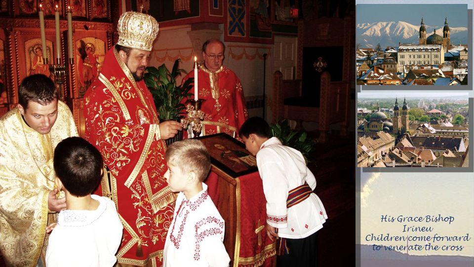 His Grace Bishop Irineu Children come forward to venerate the cross
