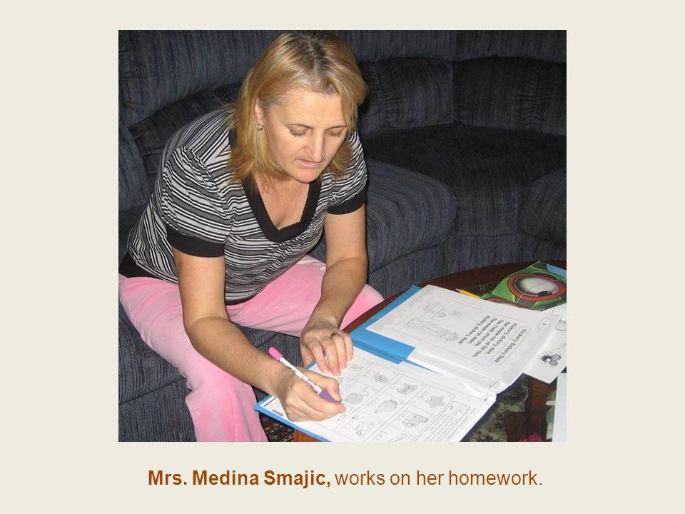 Mrs. Medina Smajic, works on her homework.