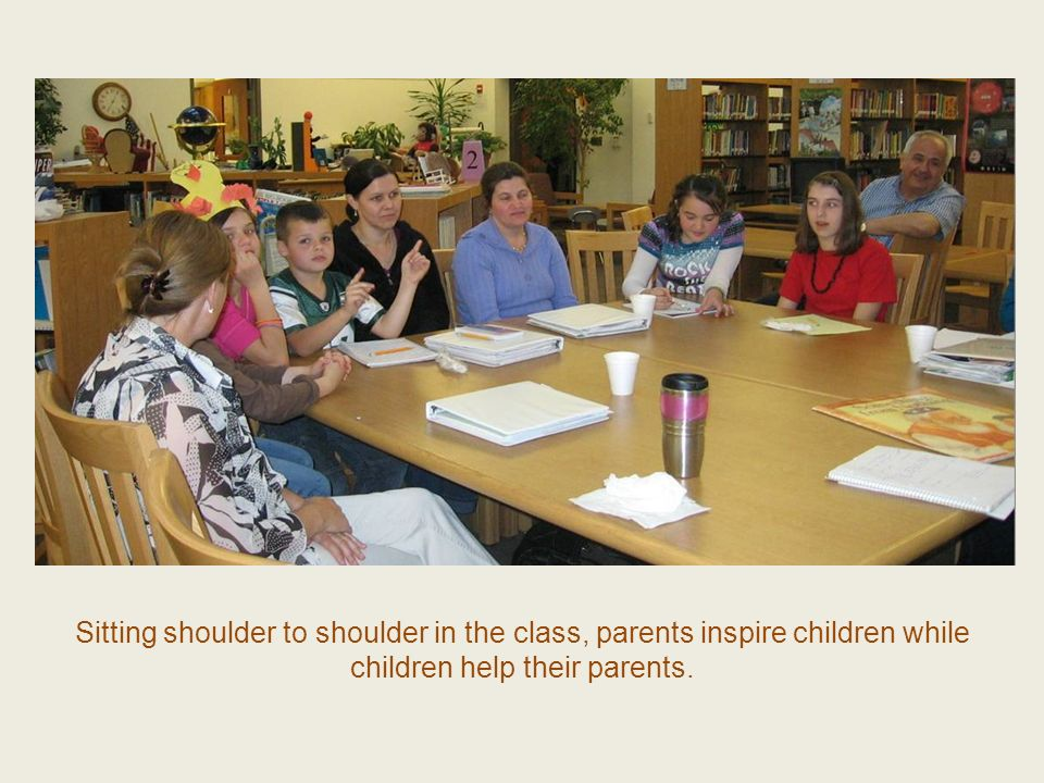 Sitting shoulder to shoulder in the class, parents inspire children while children help their parents.
