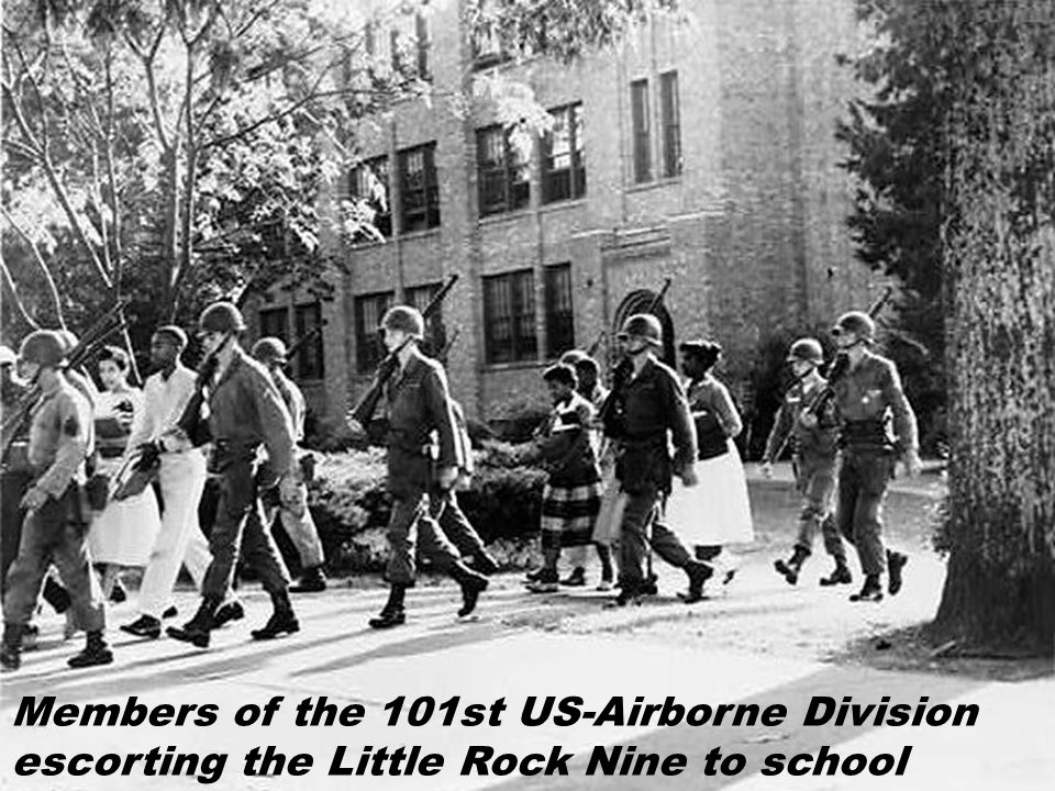 Members of the 101st US-Airborne Division escorting the Little Rock Nine to school