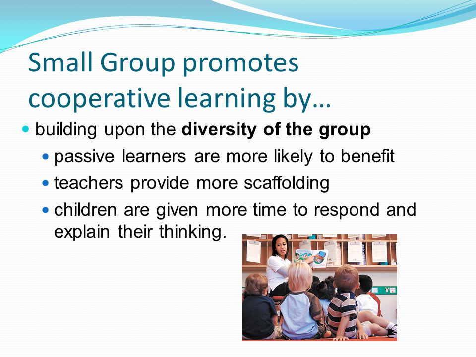Small Group promotes cooperative learning by…