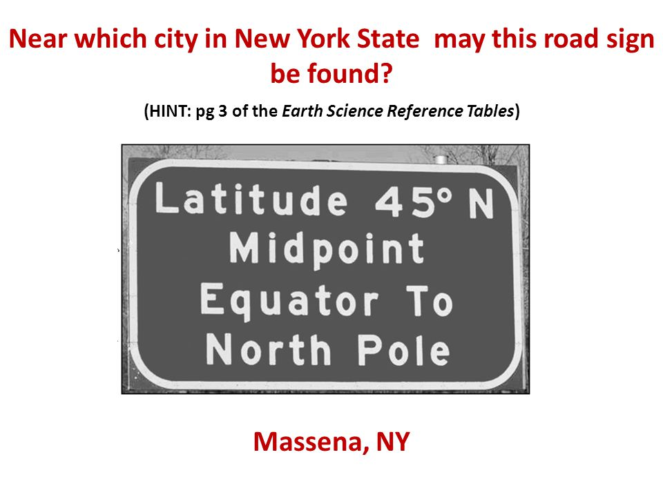 Near which city in New York State may this road sign be found