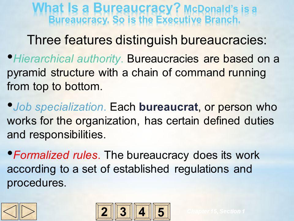 Three features distinguish bureaucracies: