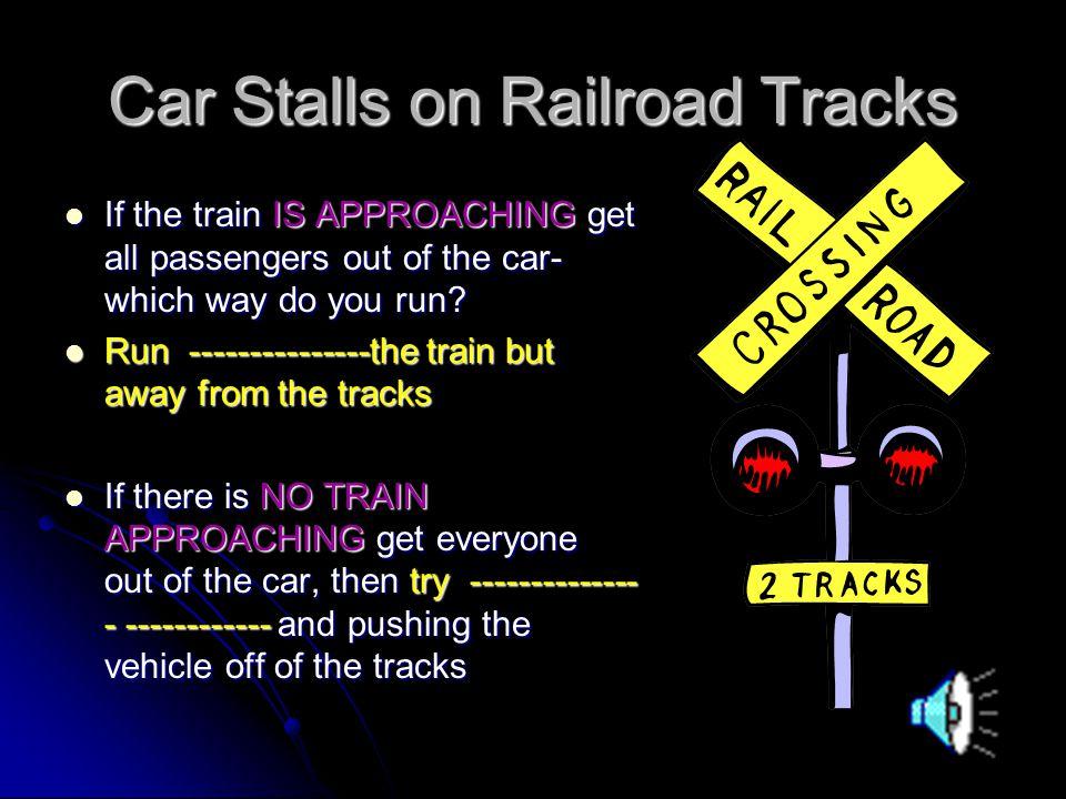 Car Stalls on Railroad Tracks