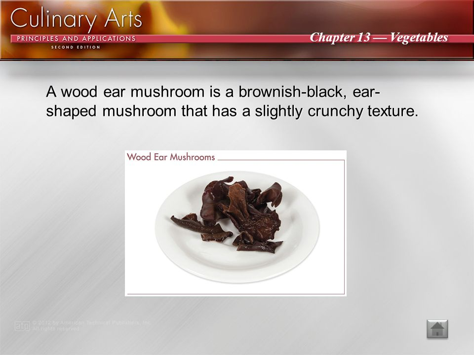 A wood ear mushroom is a brownish-black, ear-shaped mushroom that has a slightly crunchy texture.