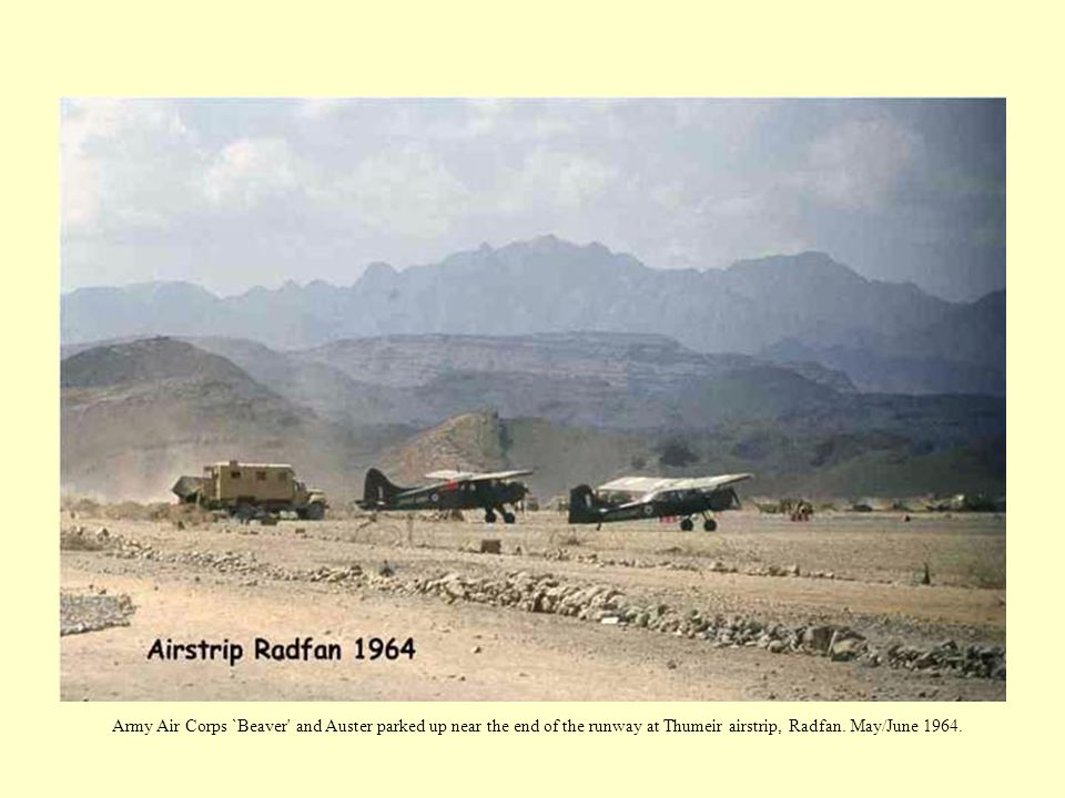 Army Air Corps `Beaver and Auster parked up near the end of the runway at Thumeir airstrip, Radfan.
