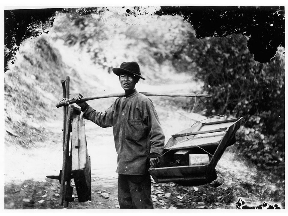 fig13_09.jpg Page 468: A photograph of a Chinese immigrant carrying equipment used in California gold mining.
