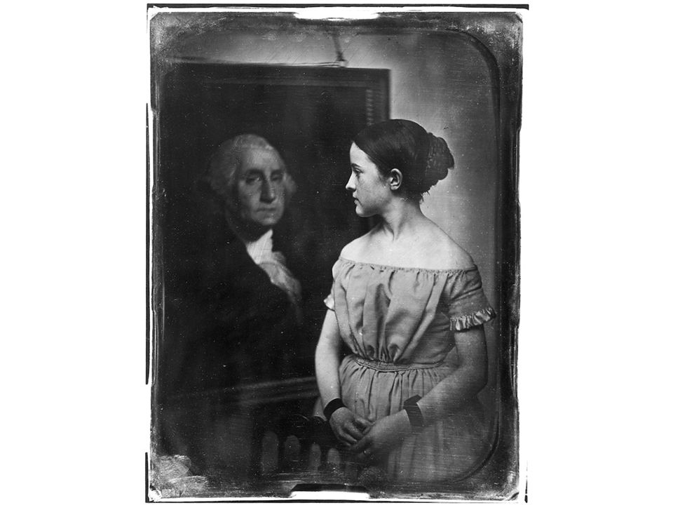 fig13_26.jpg Page 500: Young Girl with Portrait of George Washington. A patriotic photograph from.