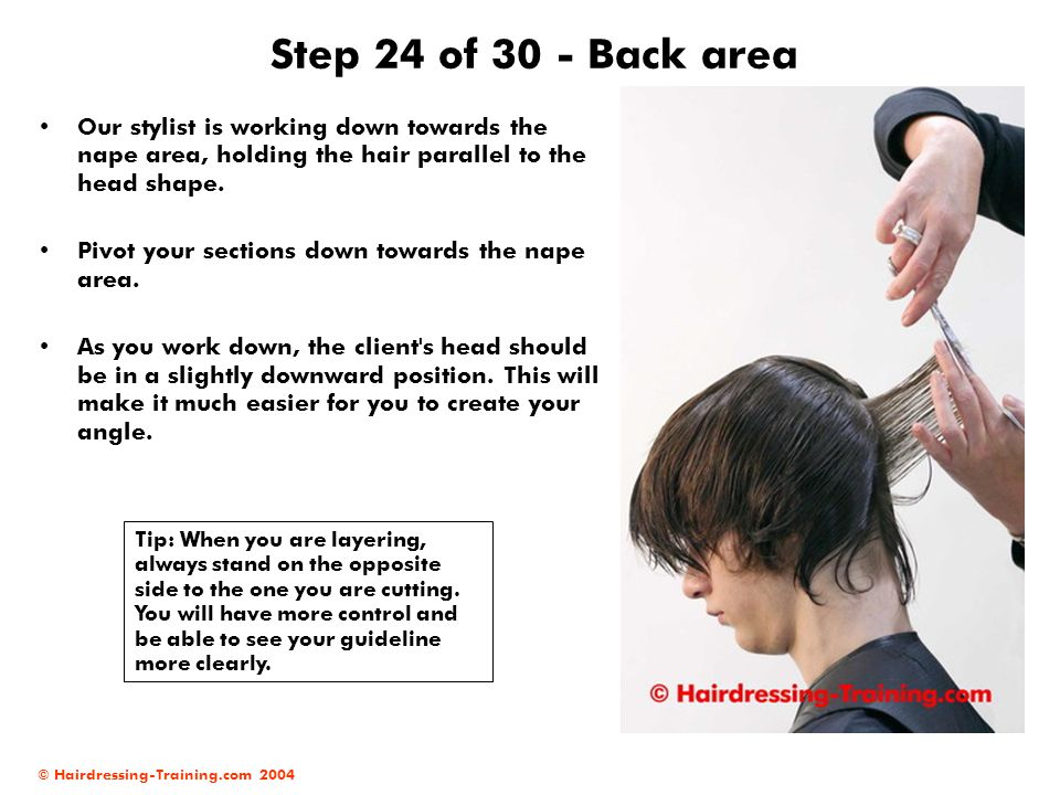 Step 24 of 30 - Back area Our stylist is working down towards the nape area, holding the hair parallel to the head shape.