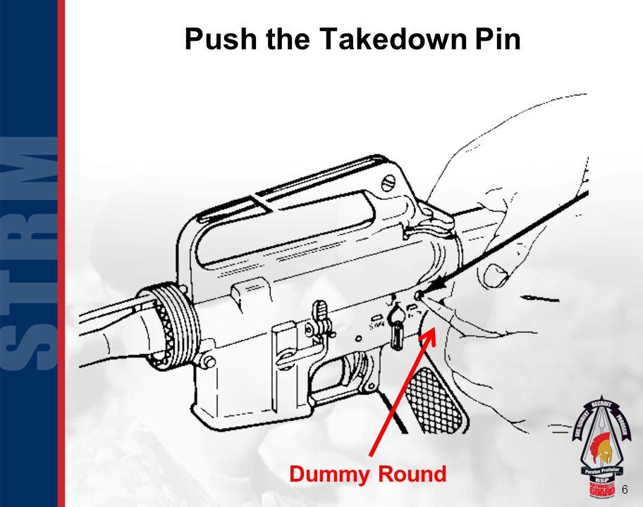 Push the Takedown Pin Dummy Round