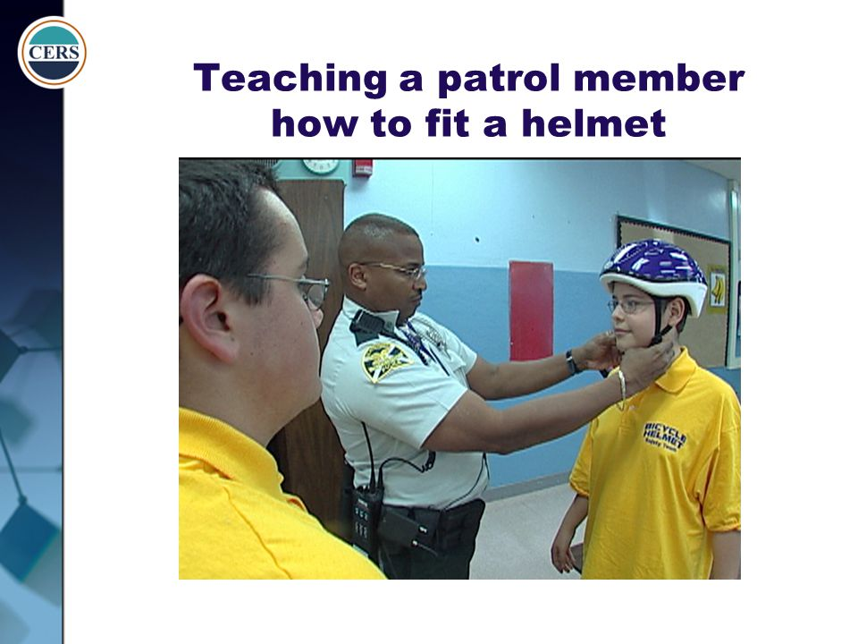 Teaching a patrol member how to fit a helmet