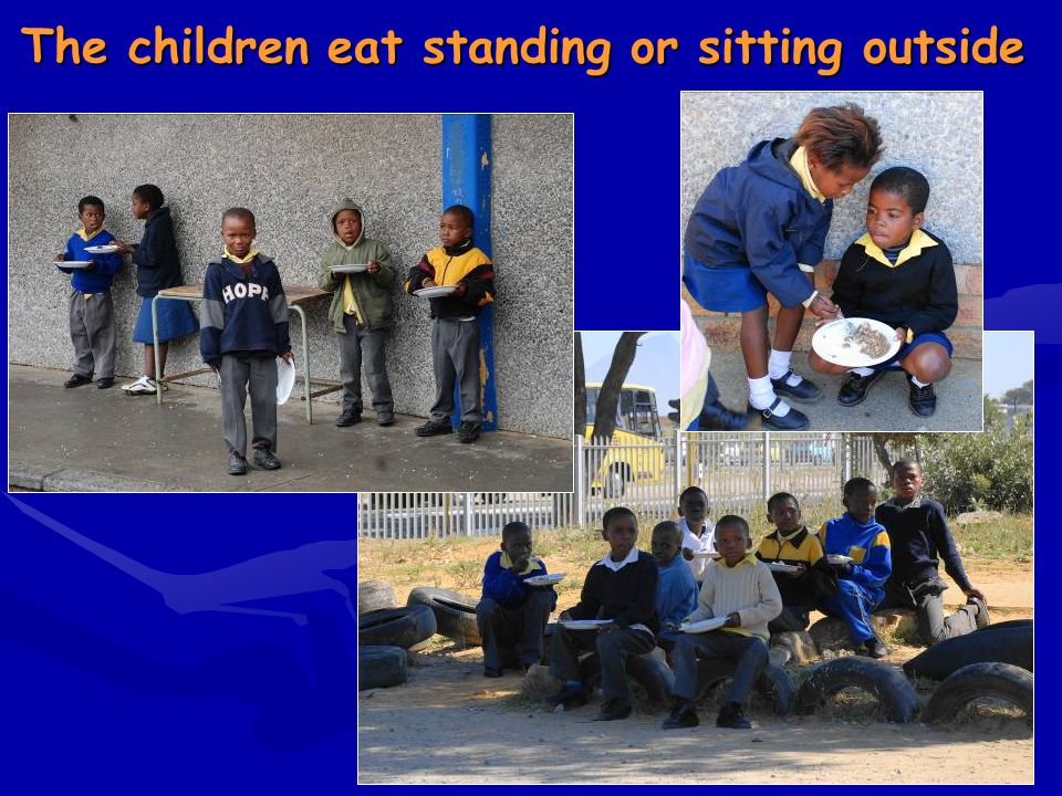 The children eat standing or sitting outside