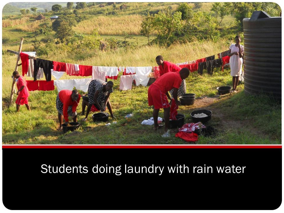 Students doing laundry with rain water