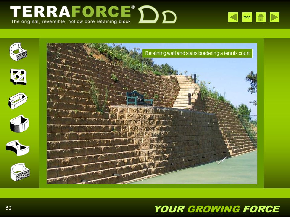 Retaining wall and stairs bordering a tennis court
