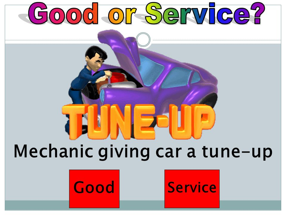 Mechanic giving car a tune-up