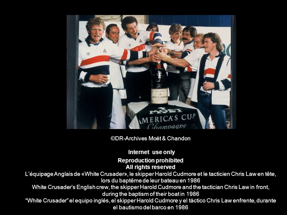©DR-Archives Moët & Chandon Internet use only Reproduction prohibited All rights reserved L'équipage Anglais de «White Crusader», le skipper Harold Cudmore et le tacticien Chris Law en tête, lors du baptême de leur bateau en 1986 White Crusader's English crew, the skipper Harold Cudmore and the tactician Chris Law in front, during the baptism of their boat in 1986 White Crusader el equipo inglés, el skipper Harold Cudmore y el táctico Chris Law enfrente, durante el bautismo del barco en 1986