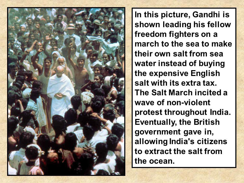 In this picture, Gandhi is shown leading his fellow freedom fighters on a march to the sea to make their own salt from sea water instead of buying the expensive English salt with its extra tax.