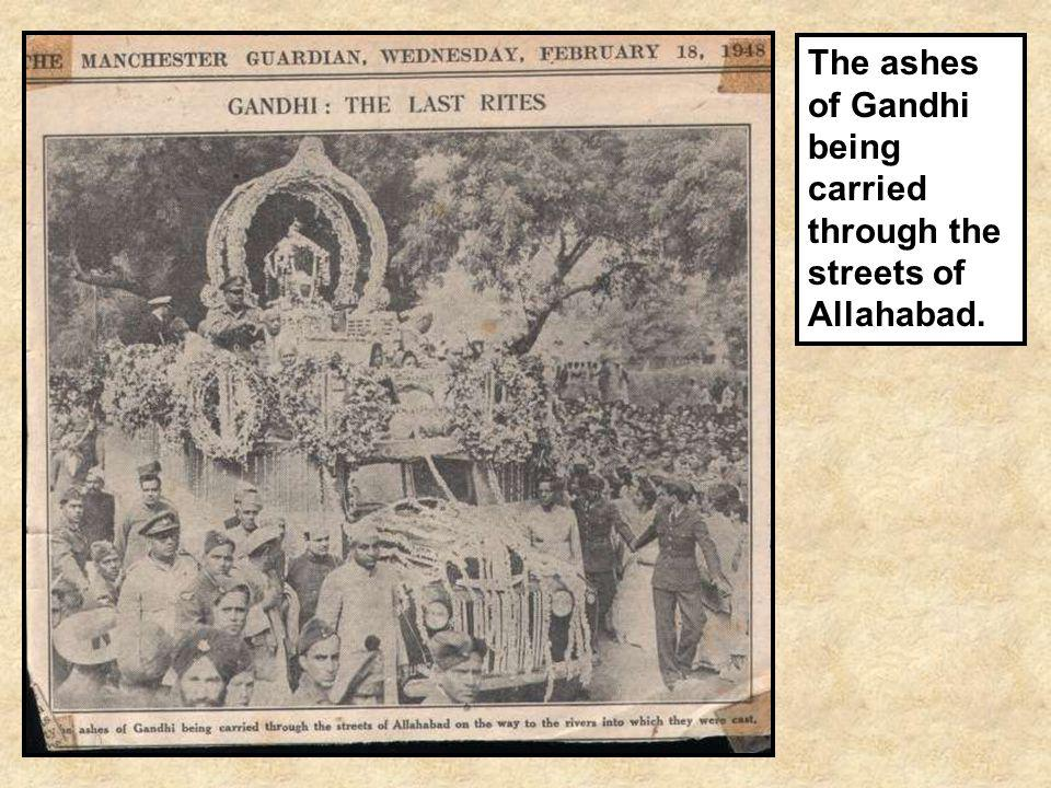 The ashes of Gandhi being carried through the streets of Allahabad.