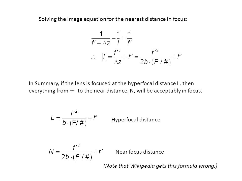 Solving the image equation for the nearest distance in focus: