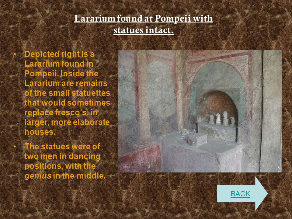 Lararium found at Pompeii with statues intact.