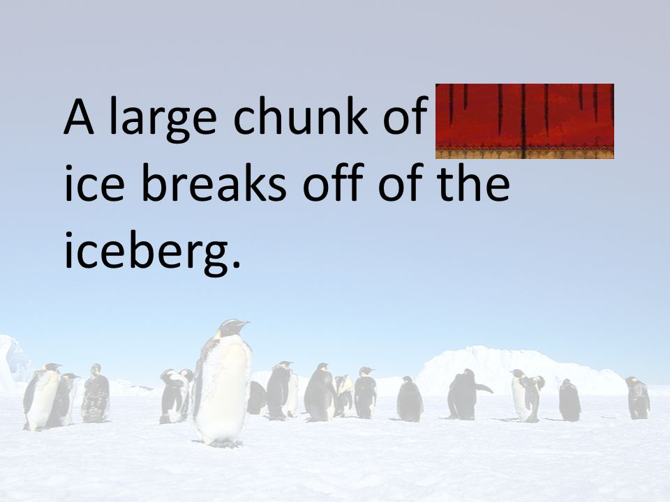 A large chunk of frozen ice breaks off of the iceberg.