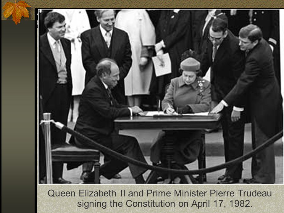 Queen Elizabeth II and Prime Minister Pierre Trudeau signing the Constitution on April 17, 1982.