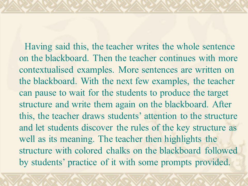 Having said this, the teacher writes the whole sentence on the blackboard.