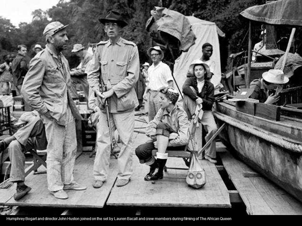 Humphrey Bogart and director John Huston joined on the set by Lauren Bacall and crew members during filming of The African Queen
