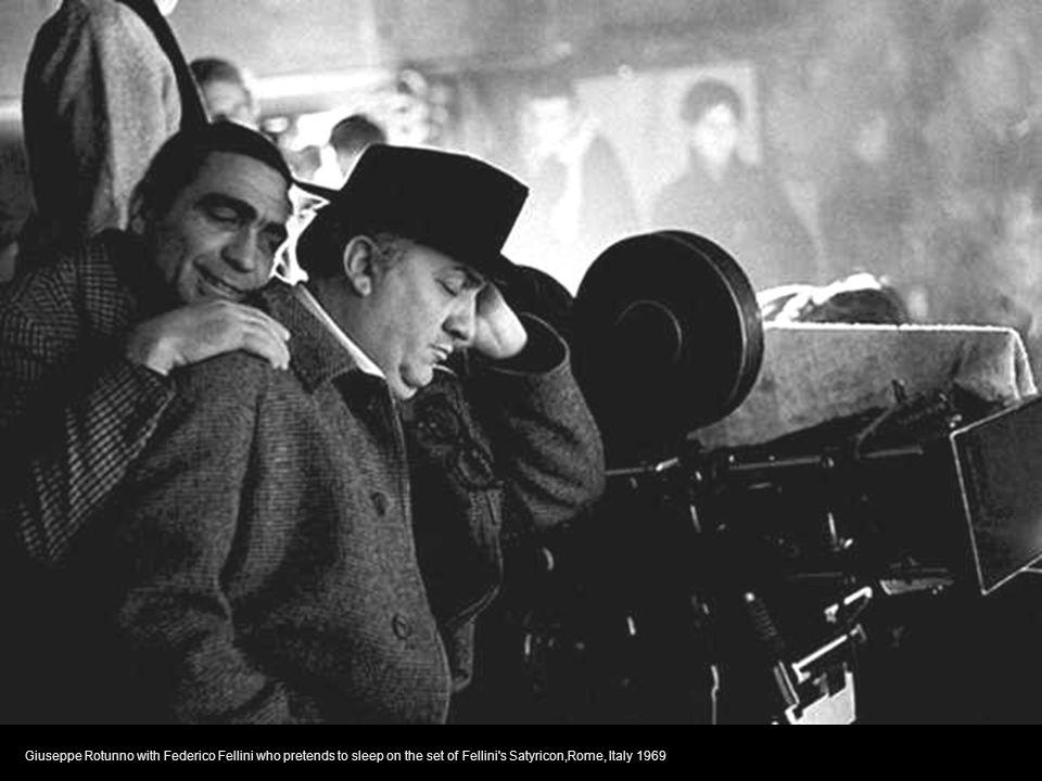 Giuseppe Rotunno with Federico Fellini who pretends to sleep on the set of Fellini s Satyricon,Rome, Italy 1969